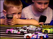 Boys playing with toy cars