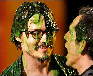 Johnny Depp covered in gunge, with Ben Stiller (AP)