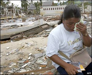 Yupin Namkhaw cries while looking at photos of her daughter who went missing during the 26th December 2004 tsunami disaster, in Khao Lak, southern Thailand
