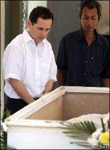 Andreas Schneider of Germany looks at the remains of this wife, Christina Schneider, April 3, in Phuket, Thailand.