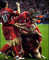 Sami Hyypia is mobbed by his team-mates
