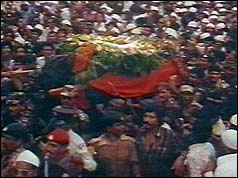 Coffin amid huge crowds