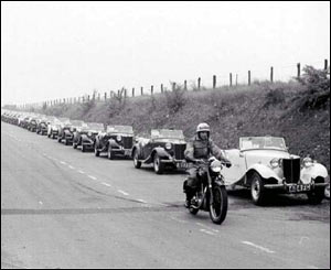A convoy of MG TD Midgets on the way to Avonmouth, Bristol, for shipment to the USA