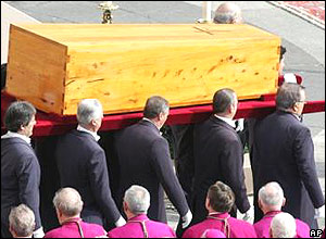 Pallbearers carry the coffin of Pope John Paul II