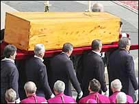 The Pope's coffin is carried at his funeral