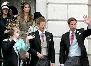 Members of the royal family follow behind them