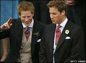 Prince Harry salutes as he arrives at the Windsor Guildhall with big brother William
