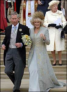 Charles and Camilla emerge from the chapel followed by the Queen. Camilla changed into a dress with a hair piece instead of a hat