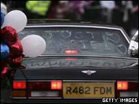 The couple leave the reception in a car decorated by Princes William and Harry