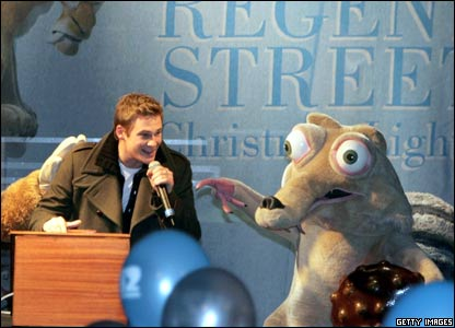 Lee Ryan, formerly of Blue, and Scrat from Ice Age prepare to turn on the lights.