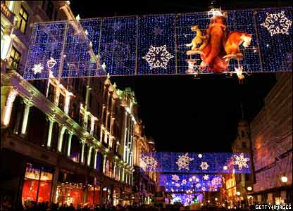 Christmas lights shine in the dark night over Regents Street, London.