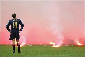 Inter's Juan Sebastian Veron can only watch as a bewildering amount of flares and bottle rain onto the San Siro pitch