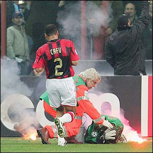 AC Milan keeper Dida is struck by a flare