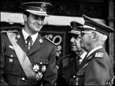 Prince Juan Carlos smiles at General Franco - 1969