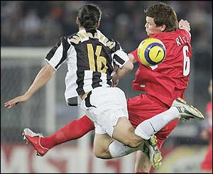 Mauro German Camoranesi of Juventus in aerial action with John Arne Riise of Liverpool