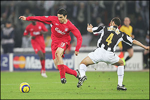 Antonio Nunez of Liverpool skips past the challenge of Paolo Montero