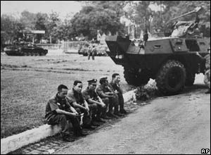 ARVN soldiers sit by the roadside