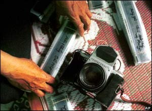 Mai Nam's negatives next to the camera he used to cover the conflict