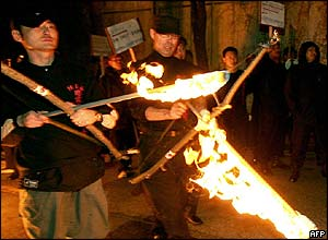 South Koreans prepare to shoot burning arrows