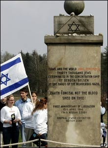 Israeli students gather beside the Jewish Memorial in the former concentration camp of Bergen-Belsen