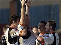 Luton players celebrate after a goal