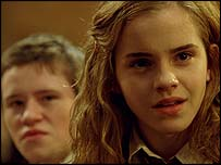 Devon Murray as Seamus Finnigan and Emma Watson as Hermione Grainger