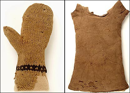 This is a child's knitted mitten and vest from the 1500s. Many poor people made their own clothes or bought them second hand.