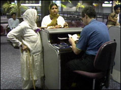 Two Asian women at passport control at UK airport