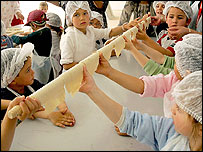 Jewish children preparing Matza, the traditional bread eaten during Passover