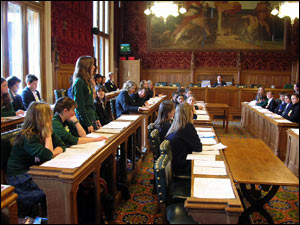 The pupils in favour of lowering the voting age sit on the right of the speaker. This is where the government would sit in the House of Commons.
