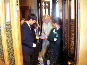 Students voted by walking back into the debating chamber through one of two doors marked 'aye' and 'no.' A 'teller' counts the number of poeople passing through the doorway.