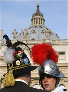 A Swiss Guard at the Vatican talks to a man in traditional Bavarian costume