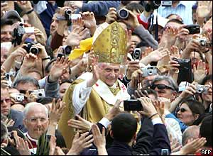 Crowds take photos of Pope Benedict XVI