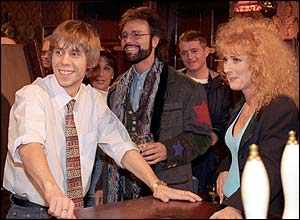 Sir Cliff Richard as an extra in an episode with Andy McDonald (Nicholas Cochrane) and Liz McDonald (Beverly Callard)