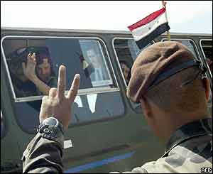 A Lebanese army commando flashes the V-sign for victory as Syrian troops leave Lebanon