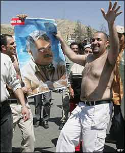 Lebanese men wave a poster of slain former PM Rafik Hariri during celebrations
