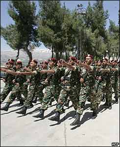 Syrian troops march during a parade