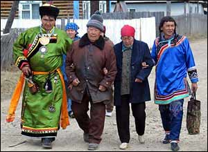 The shaman's grandfather (second left) before the initiation ceremony