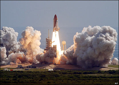 After weeks of delays, the Discovery space shuttle blasted off from the Kennedy Space Center, USA, on a 12-day mission to take supplies to the International Space Station.
