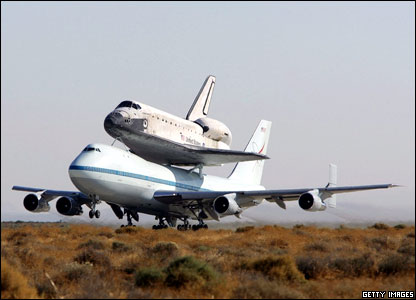 The Discovery space shuttle touched down safely back on Earth after a 12-day mission to take supplies to the International Space Station.