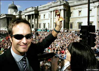 Victory for England in a dramatic Ashes series. Here's England cricket captain Michael Vaughan posing with a replica of the Ashes urn on a celebratory bus tour of London.