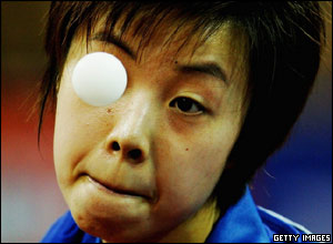 Zhang Yining of China serves a ball during a table tennis match