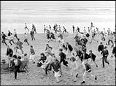 Crowd running on the beach