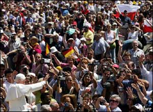 Pope Benedict XVI waves to pilgrims gathered in St Peter's Square