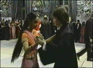 Dan dances with one of the Patil twins in  a scene at the Yule Ball