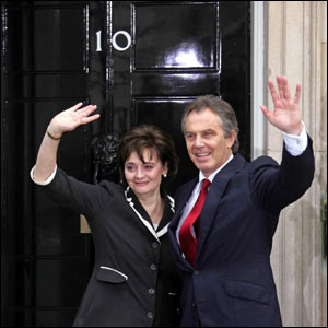 Tony and Cherie Blair arrive in Downing Street