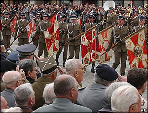 World War II veterans salute wartime army flags in Warsaw, Poland (7 May, 2005)