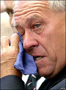 A WWII veteran sheds a tear at the Cenotaph.