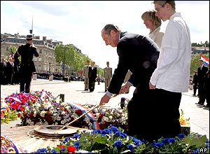 In Paris, President Jacques Chirac lit the flame at the Tomb of the Unknown Soldier under the Arc de Triomphe.