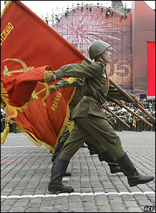 Soldiers in Soviet period uniforms march towards Red Square